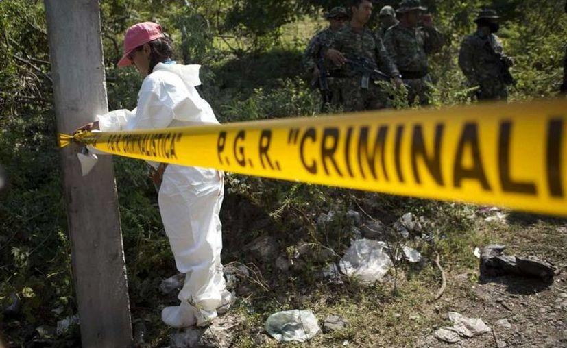 La PGR afirma que los normalistas de Ayotzinapa fueron ejecutados, quemados en el basurero de Cocula. (Archivo/Agencias)