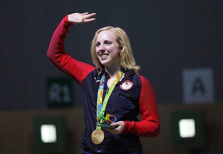 Thrasher ganó el primer oro con 208 puntos, nuevo récord olímpico de una final. (Markus Schreiber/AP)