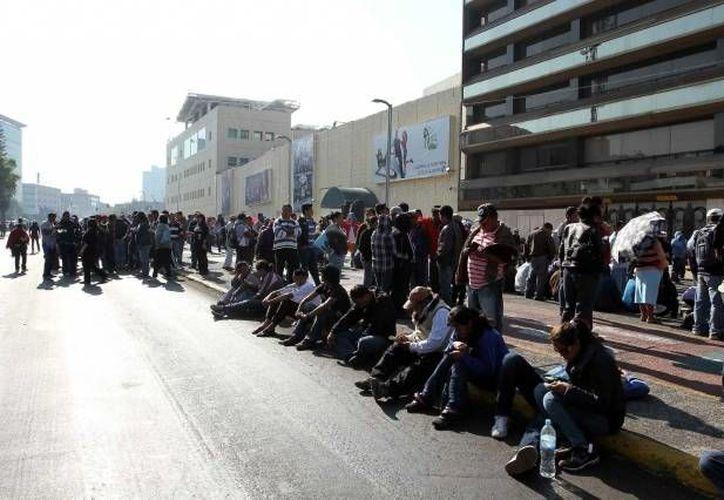 Los manifestantes tomaron plazas comerciales, bancos, autobuses públicos y una caseta de cobro.  (Agencias/Foto de contexto)