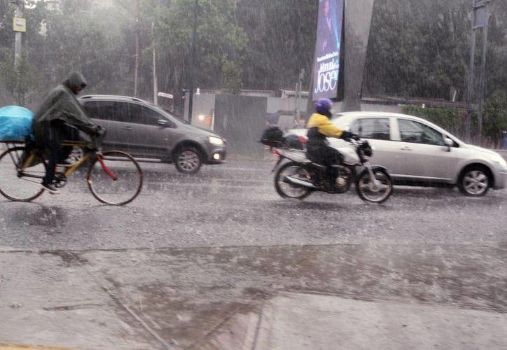 Se prevén lluvias fuertes en Durango, Zacatecas, Aguascalientes, Guanajuato, Querétaro, Hidalgo, Tlaxcala, Edomex, Ciudad de México, Morelos, Puebla y Tabasco. (Archivo/Notimex)