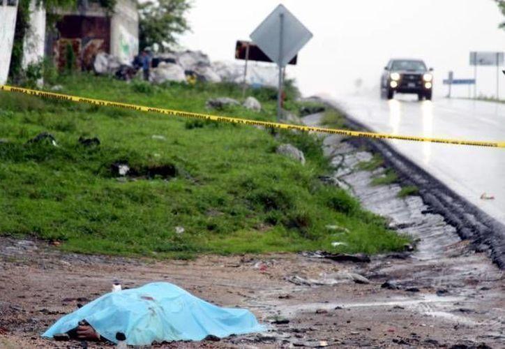 En el último año de Calderón, hubo mpas de dos mil homicidios dolosos en Michoacán, informó el Sistema Nacional de Seguridad Pública. (Archivo/SIPSE)