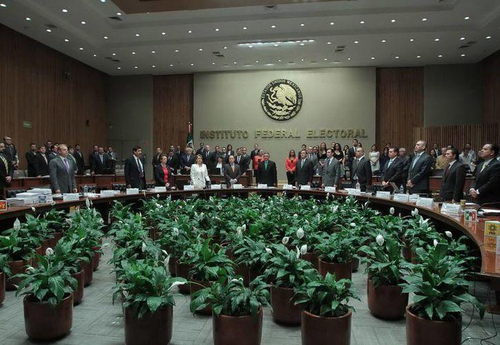 Se analiza el Dictamen Consolidado y Proyecto de Resolución de la revisión de ingresos y gastos en las campañas 2012. (Archivo Notimex)