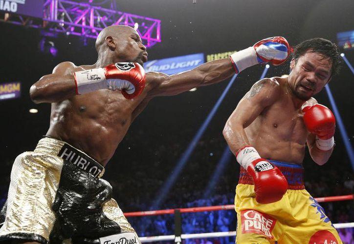 Manny Pacquiao dice que la pegada de Maywether no era tan fuerte como esperaba, pero a fin de cuentas perdió contra él en Las Vegas. (Foto: AP)