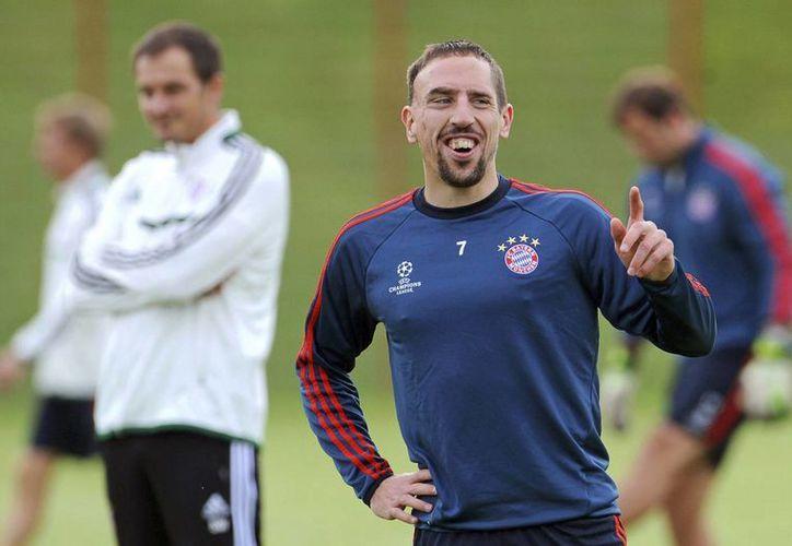 Aunque Messi y Cristiano siguen estando entre los mejores futbolistas del mundo, Ribery (foto) ganó más trofeos que ellos en la última temporada. (EFE)