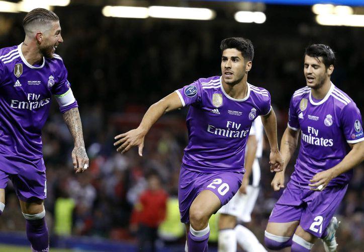 Marco Asensio se coronó en la Champions League en junio pasado. (AP)