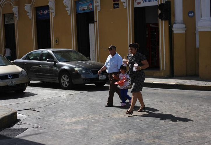 El calor que imperó el domingo favoreció para disfrutar de un domingo familiar. (Mauricio Palos/SIPSE)