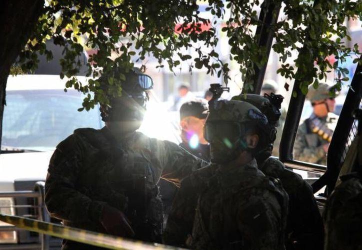 La tortura de dos militares a una mujer en Guerrero en febrero de 2015 derivó este miércoles en formal prisión para ambos y para dos federales. (Notimex/Foto de contexto)