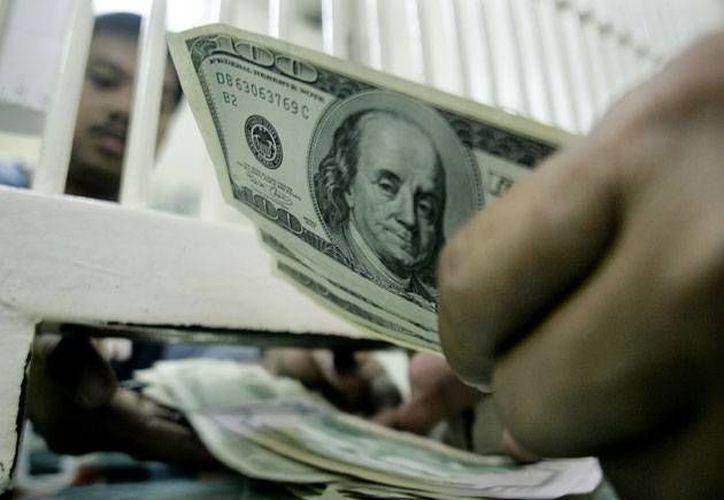 El billete verde se compró en $14.26. (Archivo/AP)