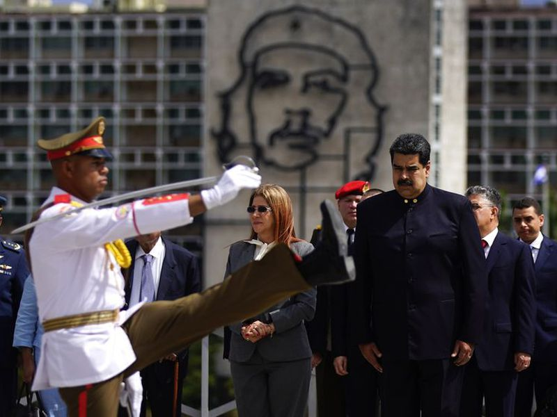 Cuban´s President Miguel Diaz-Canel, front left, escorts Venezuela's President Nicolas Maduro during his welcome ceremony at Revolution Palace in Havana, Cuba.