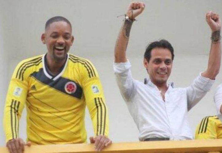 El actor Will Smith y el cantante Marc Anthony durante su festejo en Colombia. (st.elespectador.co)