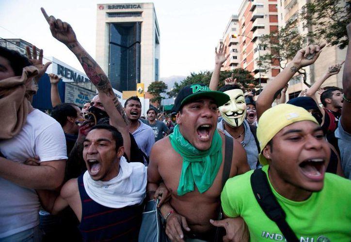 El presidente Nicolás Maduro asegura que las numerosas manifestaciones son un plan de la oposición para promover un golpe de Estado. (Archivo/AP)