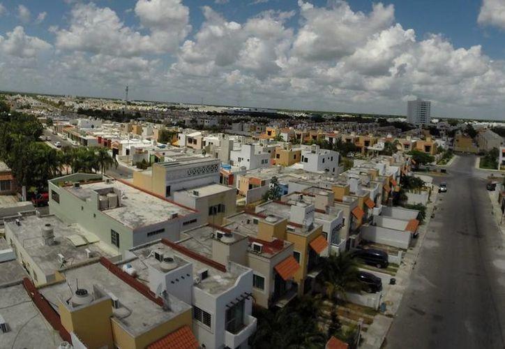 La compra y construcción de viviendas tendrá este año 5% de aumento, según las proyecciones del sector. (Victoria González/SIPSE)