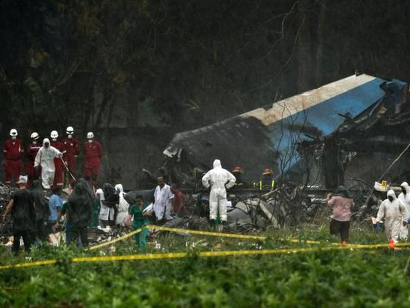 Rains begins to fall as rescue teams search through the wreckage site of Boeing 737 that plummeted into a yuca field with more than 100 passengers on board, in Havana, Cuba. (AP)