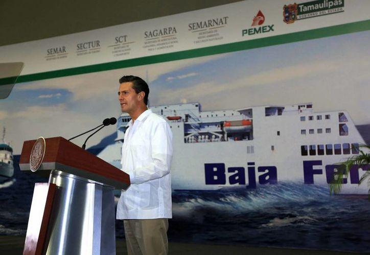 El presidente Enriqueña Peña Nieto durante su mensaje con motivo del Día de la Marina, en Tampico, Tamaulipas. (Notimex)