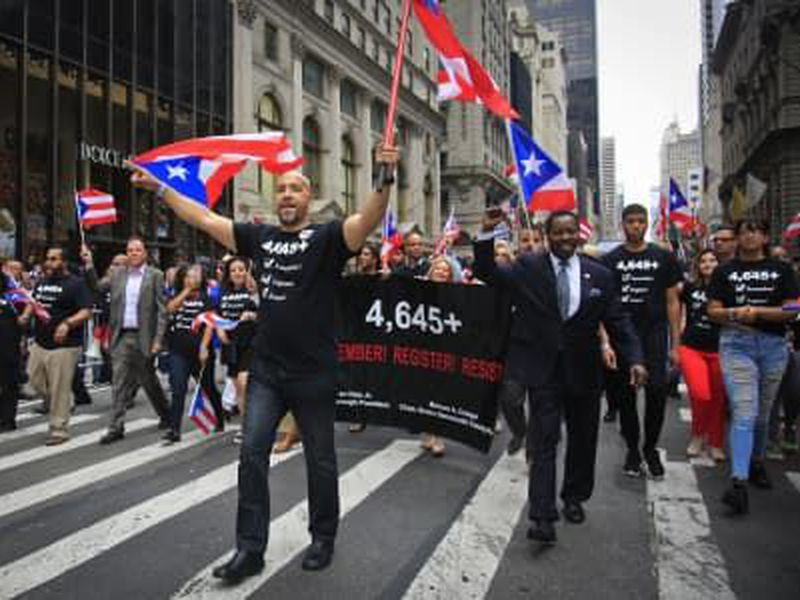 Bronx Borough President Ruben Diaz, center, leads a group of state and city officials during the Puerto Rican Day Parade, in New York.
