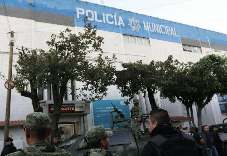 El Ejército y Fiscalía investigan a elementos de la policía municipal de Tlaquepaque. (Foto: Fiscalía de Jalisco)