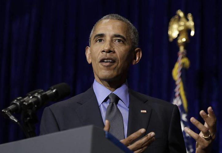 El presidente Barack Obama cuenta con un reconocimiento más, científicos bautizaron a un parásito con su nombre. (AP/Carolyn Kaster)