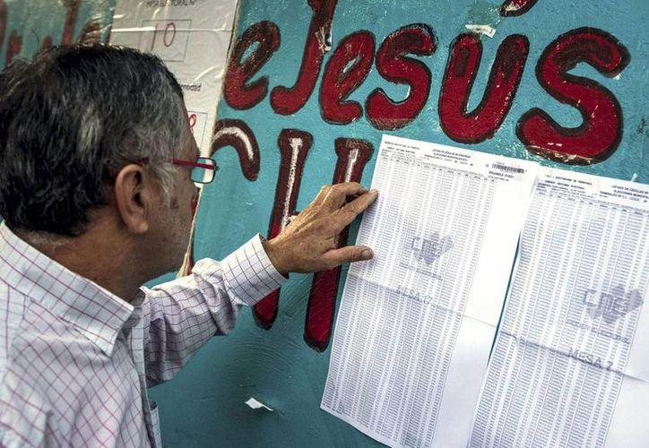 Las elecciones en Venezuela transcurren con normalidad, salvo por algunos incidentes menores. Esta misma noche se anunciarían los resultados. (EFE)