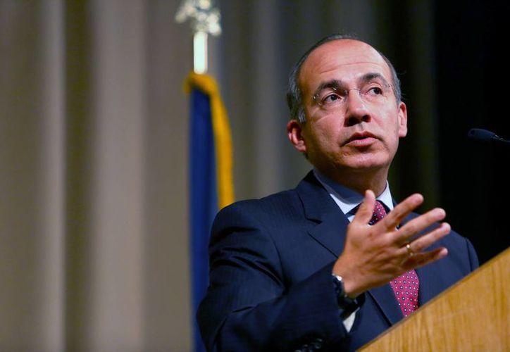 Calderón inauguró con su discurso la presentación de oradores 2013-2014 del club. (Agencias)