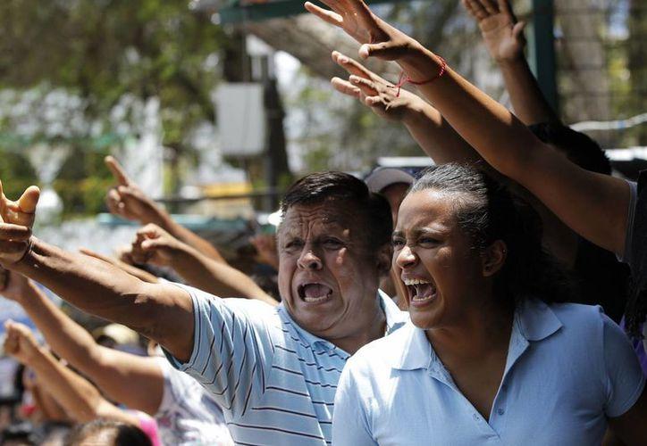 Ciudadanos de Tixtla se quejaron de que el gobierno de Guerrero no cumplió con su ofrecimiento de velar por la seguridad en las elecciones. (EFE)