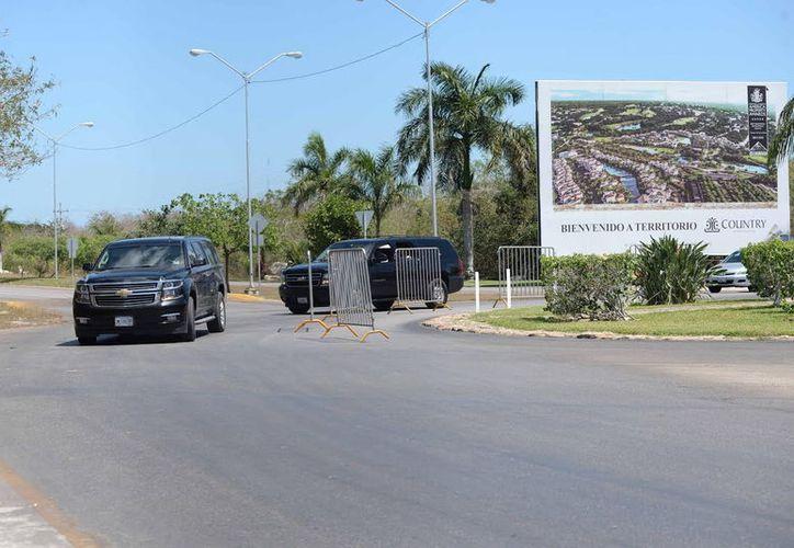 Elementos del Estado Mayor Presidencial, en el Yucatán Country Club. (Milenio Novedades)
