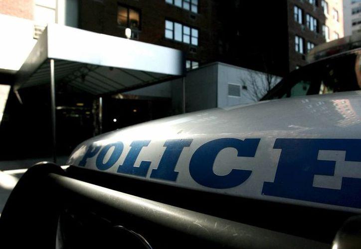 Hasta el campus universitario se han trasladado numerosos miembros de la Policía y agentes del cuerpo de elite SWAT. (Archivo/EFE)