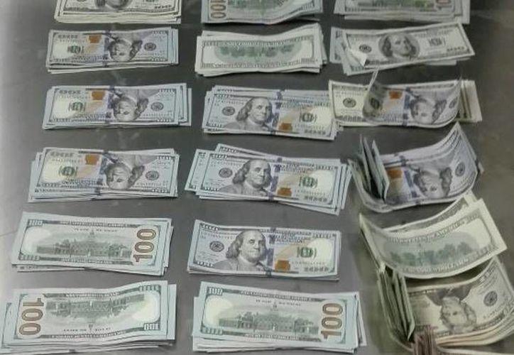 El sujeto detenido pretendía trasladar el dinero a Bogotá, Colombia. (Redacción/SIPSE)
