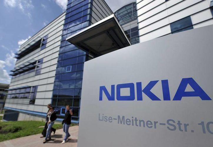 Los 32,000 empleados de la nómina de Nokia pasan también al control de Microsoft. (Efe)