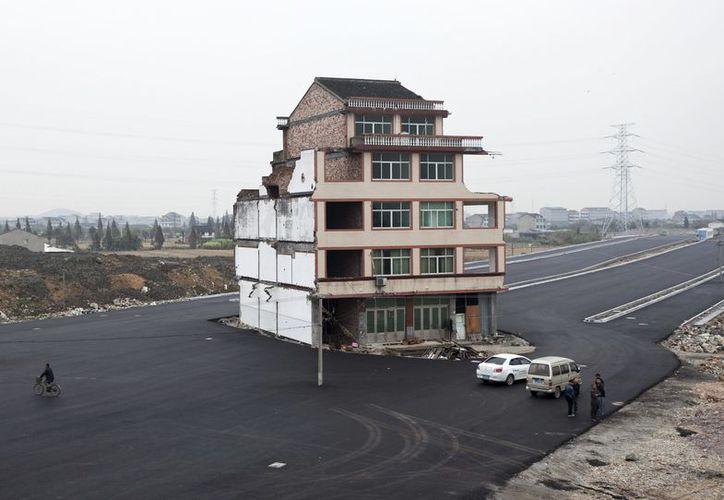 La cnstrucción en la provincia de Zhejiang, es conocida como casa clavo. (Foto: Agencias)