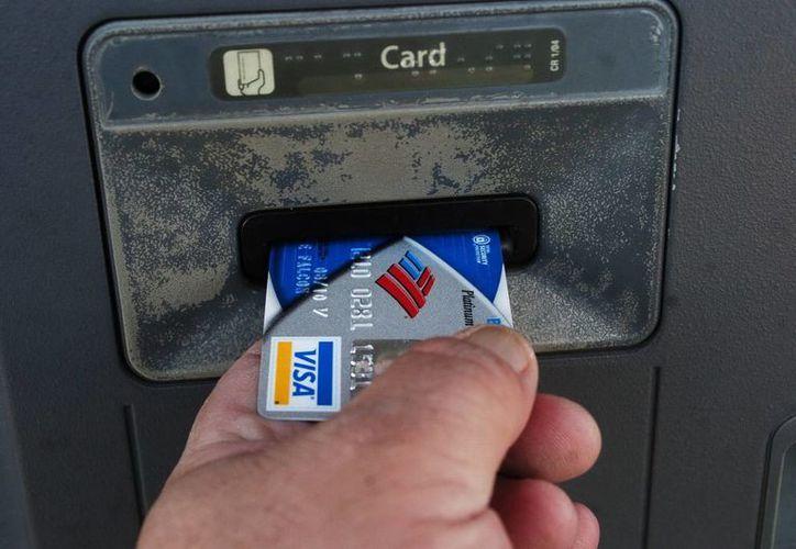 En diciembre de 2012 obtuvieron 5 mdd en operaciones ilegales de cajeros automáticos. (EFE)
