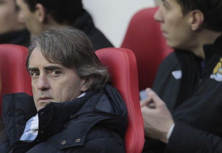 Mancini y Balotelli fueron captados discutiendo en el entrenamiento de ayer. (Foto: Agencias)