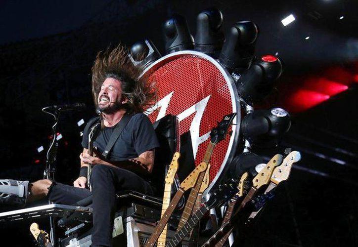 The Foo Fighters, Natalie Portman, U2 y otros artistas cancelaron presentaciones en París luego de los fatales ataques terroristas del viernes. Imagen de Dave Grohl, vocalista y guitarrista de Foo Fighters. (Foto de Greg Allen/Invision/AP)