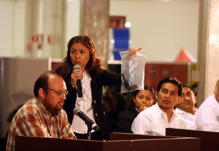 El perito suministra información a los tribunales sobre los puntos litigiosos que son materia de su dictamen.  (Milenio Novedades)