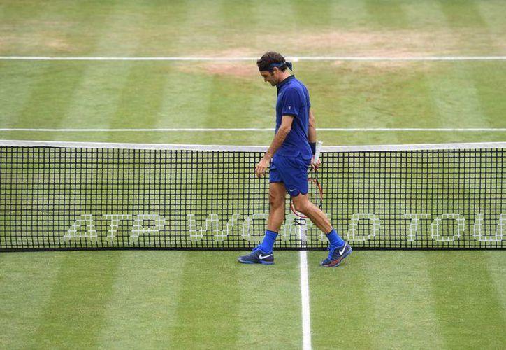 Roger Federer quedó eliminado en semifinales y continuará con su preparación de cara al torneo de Wimbledon. (AP)