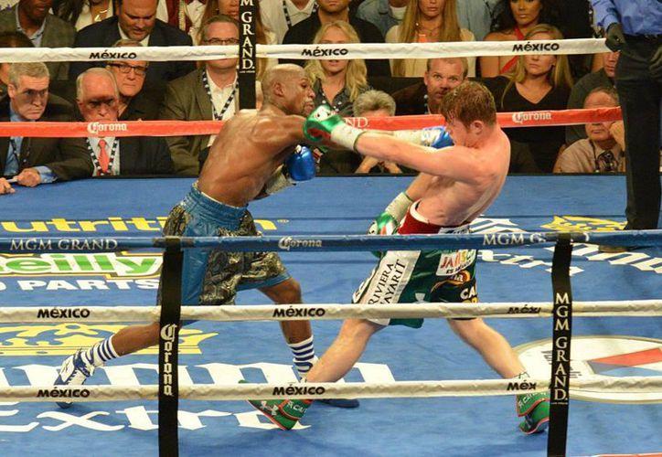 Floyd Mayweather derrotó a 'Canelo' Álvarez  por decisión el sábado por la noche. (Notimex)
