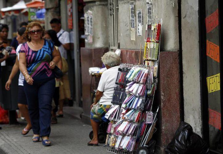 Temen empresarios regreso de vendedores ambulantes. (Milenio Novedades)