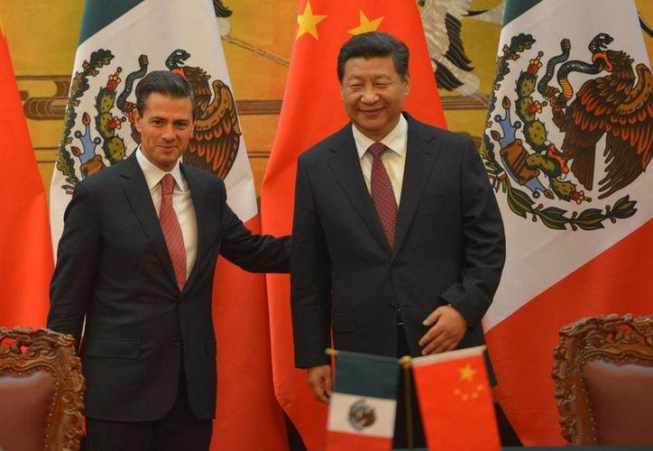 Los presidentes de México y China anuncian dos fondos, uno de ellos entre Petróleos Mexicanos y tres empresas chinas por 5 mil mdd. (Foto: Notimex)