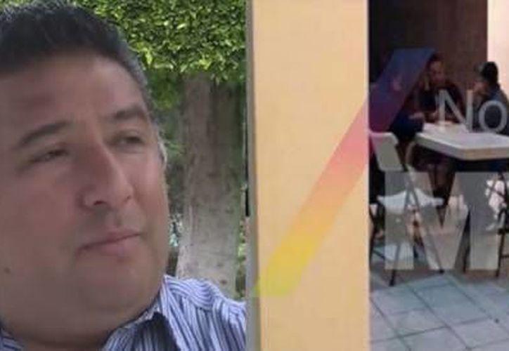 Eliseo Caballero (i), corresponsal de Televisa en Michoacán, acepta que aparece en un video con 'La Tuta' (d) y dice que es difícil decirle que no a ese tipo de personas. (Imagen tomada de artisteguinoticias.com)