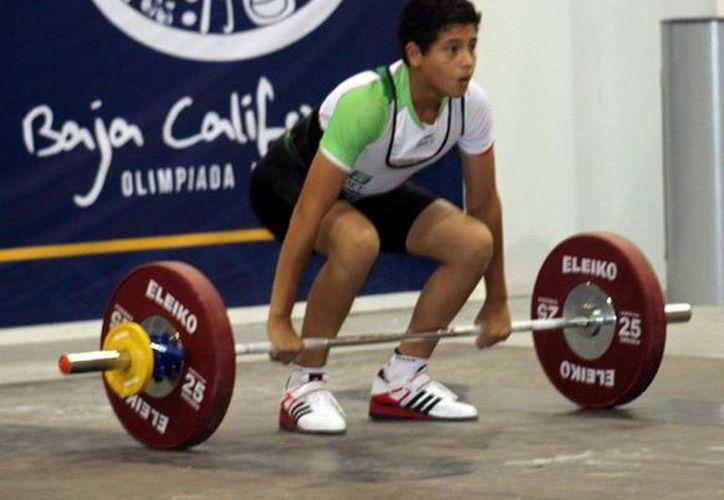 Logran primeras medallas en pesas. (Milenio Novedades)