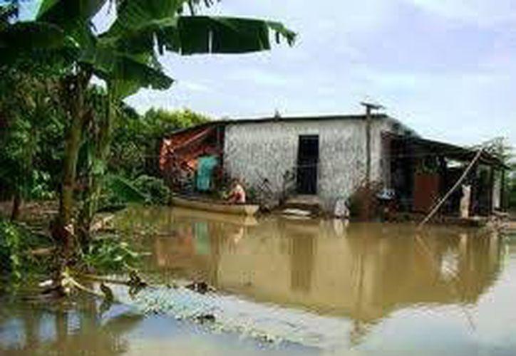 En algunas localidades, el agua alcanzó hasta un metro y medio de altura. (Carlos Horta/SIPSE)
