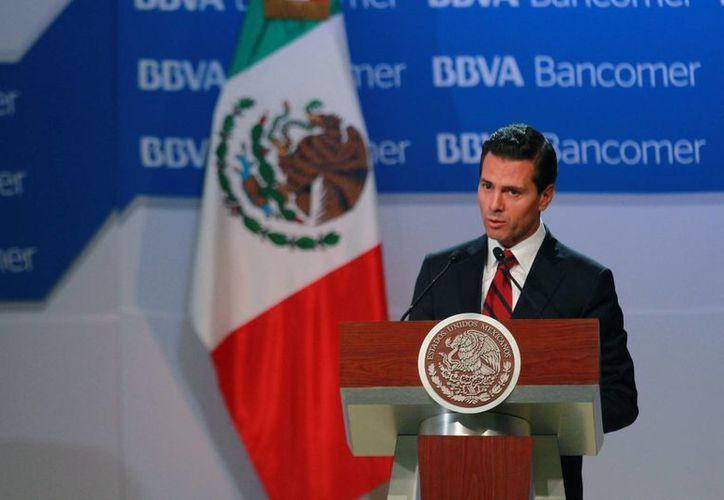 El presidente Enrique Peña Nieto participó este lunes 6 de junio de 2016 en la Reunión Nacional de Consejeros de BBVA Bancomer 2016. (Notimex)