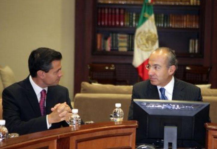 La noche del viernes, los presidentes saliente y el entrante, Felipe Calderón y Enrique Peña Nieto, encabezarán una ceremonia de traspaso de poderes en Palacio Nacional. (Archivo/Milenio)