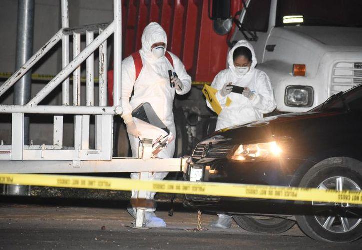La víctima fue acribillada por unos sujetos que viajaban a bordo de una camioneta. (Redacción/SIPSE)