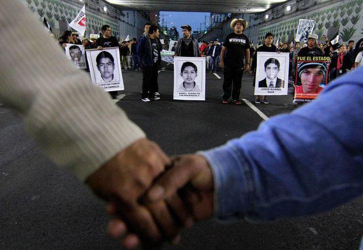 La ONU dijo que el caso de los estudiantes desaparecidos de Aytozinapa es solo la punta del iceberg de la inseguridad en México. La imagen corresponde a una protesta por lso estudiantes de la Normal Rural. (Archivo/NTX)