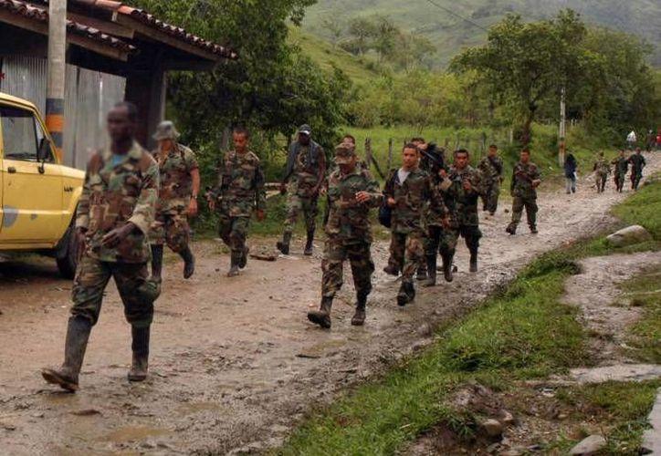 Los policías asesinados por las FARC habían sido secuestrados en el sitio Puerto Nuevo cuando viajaban en un vehículo particular. (EFE/Contexto)