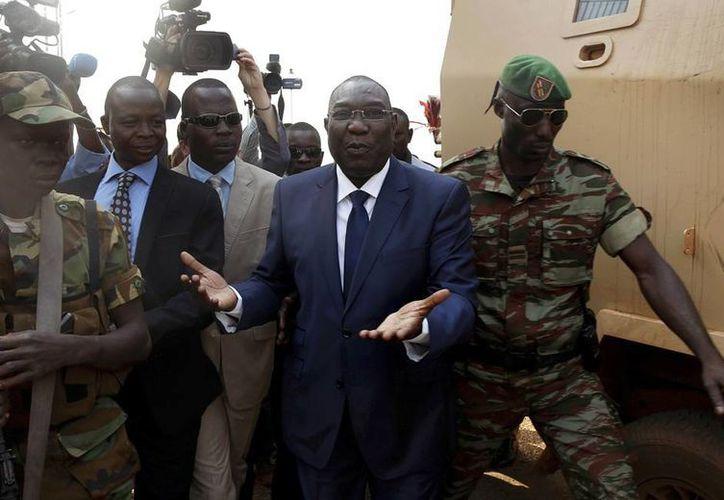 Michel Djotodia (centro), presidente de la República Centroafricana, renunció hoy viernes, junto con el pleno del Gobierno de transición. (Archivo/Agencias)