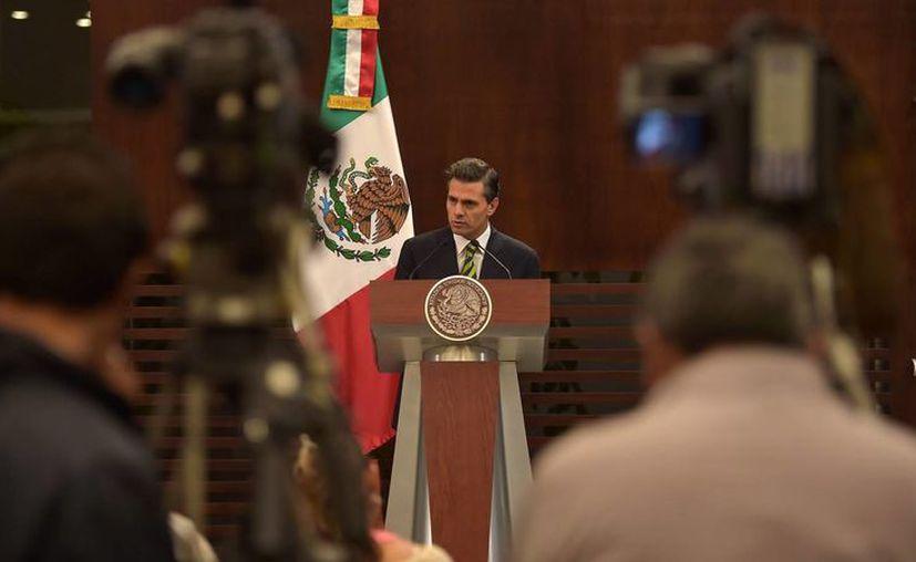 En su mensaje tras su regreso de Asia, Peña Nieto se refirió a las manifestaciones violentas de los últimos días. (Notimex)