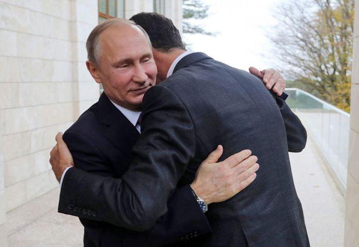 El mandatario ruso le dijo a Assad que la guerra en Siria está a punto de terminar. (Foto: The Washington Post)
