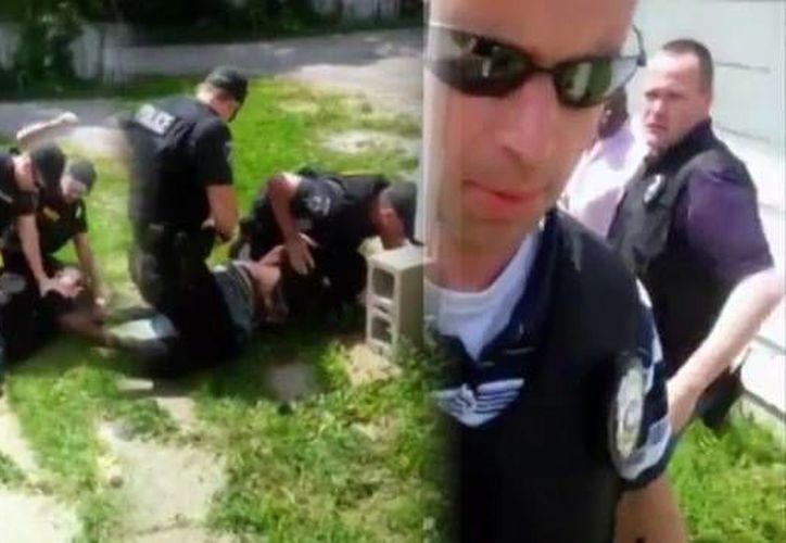 Imágenes de los agentes que utilizaron el 'taser' contra el sospechoso. (YouTube)