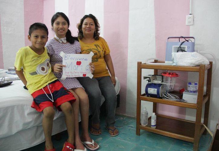 La menor está feliz con su familia en casa. (Consuelo Javier/SIPSE)